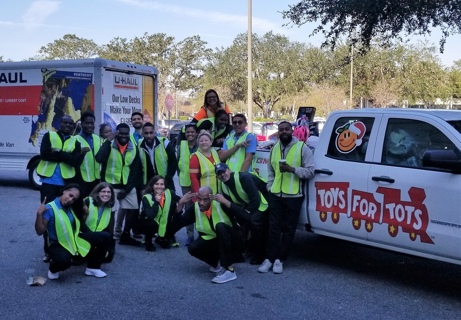 MCO Orlando, led by President Ashley Allen, donates toys to Toys for Tots.
