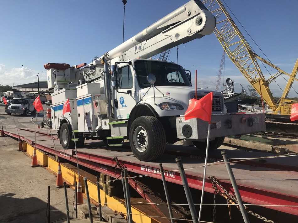 More than 100 Florida Power & Light Company (FPL) trucks and electric equipment are loaded onto barges at the Port of Fort Pierce in Fort Pierce, Fla., Dec. 28, 2017. FPL lineworkers and support staff will meet up with the trucks and equipment in early January and begin working in Puerto Rico with other energy companies to help restore service to residents who remain without power following Hurricane Maria. Photo credit: Christopher McGrath for FPL.