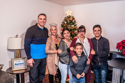 "Aaron's, Inc., a leading omnichannel provider of lease-purchase solutions, and its divisions Aaron's and Progressive Leasing, contributed the furnishings for two surprise home presentations to Phoenix residents Julia Campos (and family pictured here) and Angelica Valentin last week as part of the ""Homes for the Holidays"" program sponsored by retired NFL quarterback Kurt Warner, his wife Brenda, their First Things First Foundation (FTFF) and Habitat for Humanity Central Arizona."