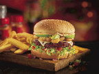 In the spirit of the New Year, Red Robin Gourmet Burgers and Brews is encouraging guests to keep their resolutions on track with its new Gourmet Veggie Burger, a custom-blended, ancient-grain-and-quinoa veggie patty piled high with Swiss cheese, Parmesan-sprinkled mushrooms, tomato bruschetta salsa, fresh avocado slices, sun-dried tomato spread and shredded romaine on a whole grain bun. It's a veggie burger finally done right and available at Red Robin restaurants nationwide. (PRNewsfoto/Red Robin Gourmet Burgers...)