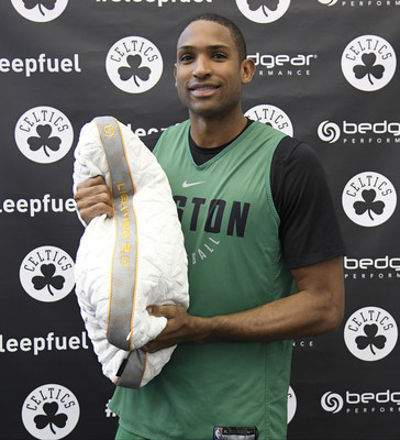 Al Horford holding up his BEDGEAR pillow