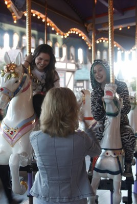 Sandy Segerstrom Daniels takes a photo of actress and Global Genes ambassador, Madison McLaughlin, with Shira Strongin (rare disease patient advocate) at Festival of Children's Carousel of Possible Dreams at Disneyland in October 2016.