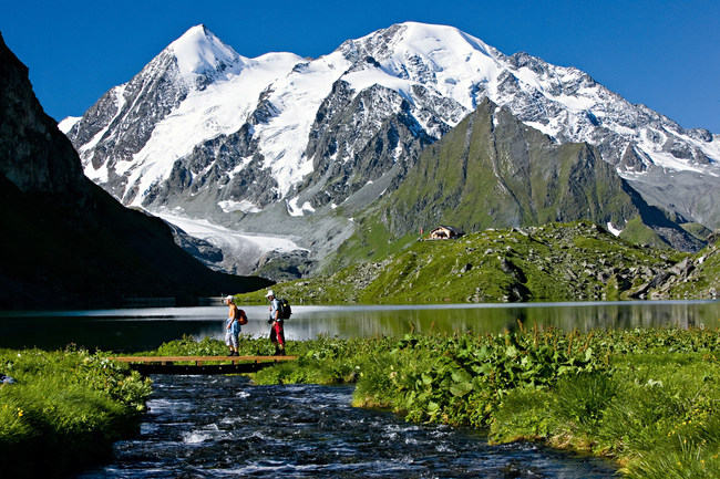 Hikers near Lac Louvie in the Swiss Alps. Photo Courtesy Switzerland Tourism