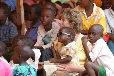 Winnie Barron, 2017 World of Children Humanitarian Award Honoree, sits with orphans in Makindu, Kenya, who she has dedicated much of her life to serving.
