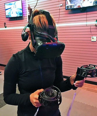 Injured veterans and their guests donned virtual reality gear to experience the latest in gaming technology.