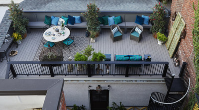 AZEK® Building Products launches three new decking colors in its Vintage Collection at the International Builders' Show, including Coastline™, as featured on this rooftop deck.