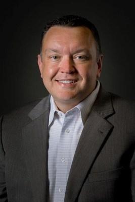 Mark E. Denman, President, Genesis Credit