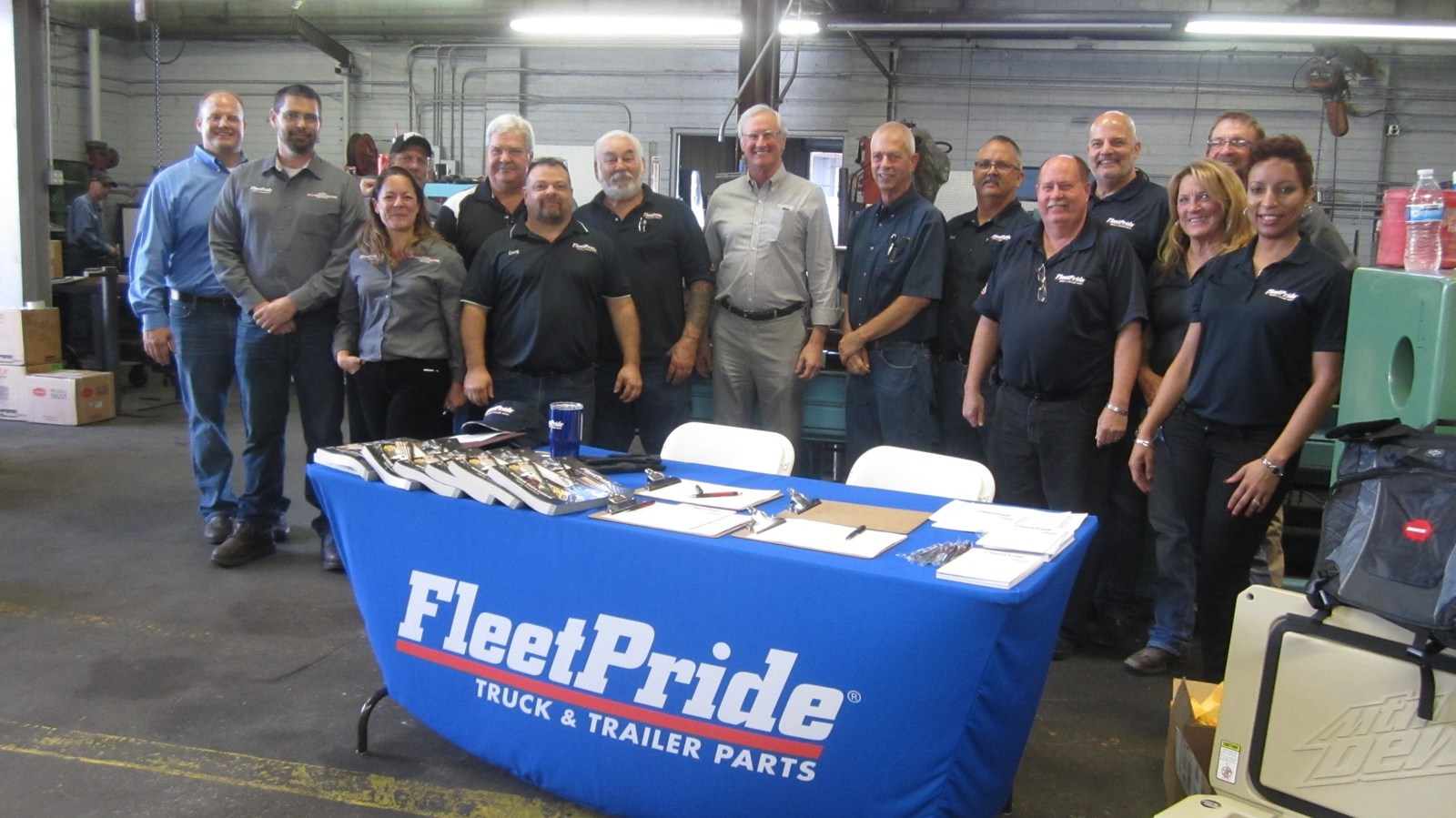 Members of FleetPride management join team members from the company's Phoenix location to mark the grand reopening of the branch and its new hydraulic shop.
