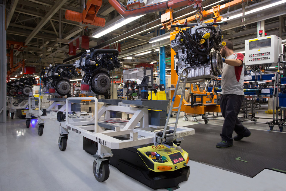 125 automated guided vehicles (AGV) share the workspace every day with 7,000 employees and ease their workload (PRNewsfoto/SEAT SA)