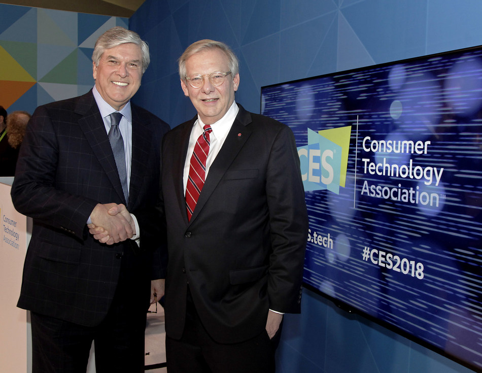 At CES 2018, National Association of Broadcasters President and CEO, Gordon Smith (left), congratulates LG Electronics USA Senior Vice President, John Taylor, for the company's pioneering work behind the ATSC 3.0 Net Gen TV standard.