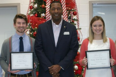 Georgia Power area manager, Tray Leslie, presented New Teacher Assistance Grants to two recipients, J. Seth Warner and Darby Smith Bozeman. (PRNewsfoto/Georgia Power)