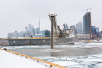 The first shipment of core stone is deposited in the Inner Harbour – the first step in building new land around Essroc Quay as part of the Cherry Street Lakefilling project. (CNW Group/Waterfront Toronto)