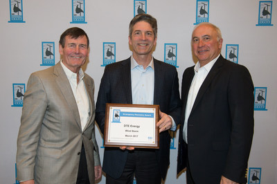 Tom Kuhn, EEI president (left) presents award to Gerry Anderson, DTE Energy chairman and CEO (center) and Jerry Norcia, DTE Energy president and COO (right).