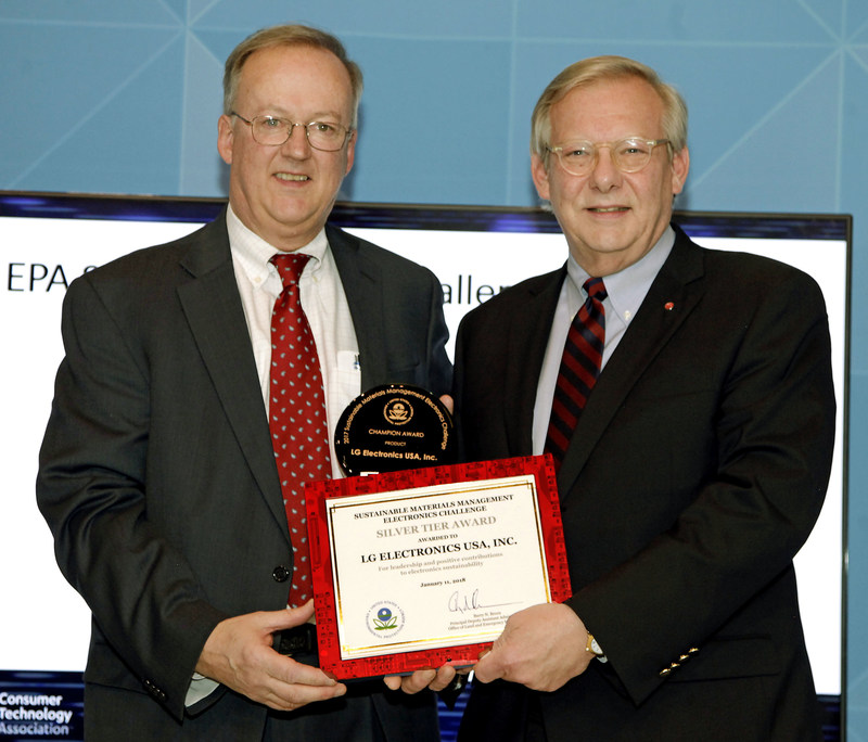 "Barnes Johnson, Director of the EPA Office of Resource Conservation and Recovery (left) awards John Taylor, Senior Vice President of Public Affairs, LG Electronics USA, the EPA Champion Award on ""CES® 2018 Sustainability Day."" The company received the Product Champion Award for LG OLED TVs, which are designed to reduce environmental impact and to be easier to disassemble and recycle."