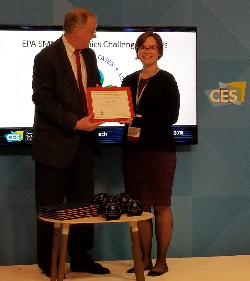 Caitlin Sanchez, VIZIO Counsel receives the EPA's Sustainable Materials Management Electronics Award from Barnes Johnson, EPA Director of the Office of Resource Conservation and Recovery.