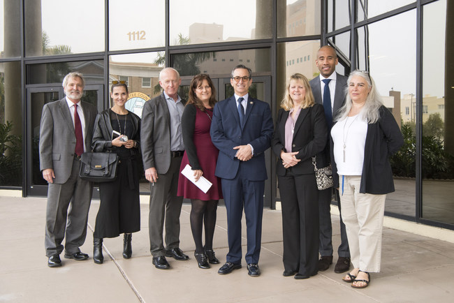 From left to right: Caleb Grimes, Gobuty's Attorney; Monique Viehman, Pearl Homes Marketing Director; Gary Carmack, Pearl Homes Energy Development Officer; Darenda Marvin, Land Planner; Marshall Gobuty, President of Pearl Homes; Beth McDougal, Lead Architect of Hunters Point; Dahntay Jones, President and Manager of Pearl Homes Home Solutions Division; and Janet McIlvaine, FSEC Senior Research Analyst.