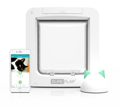 The Microchip Pet Door Connect, shown with the Hub, wirelessly connects to the home router allowing pet owners to monitor and control when pets come and go using the Sure Petcare app on their smartphones.