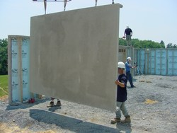Installation of a Superior Walls precast concrete panel system to create an energy-efficient foundation for a new home.