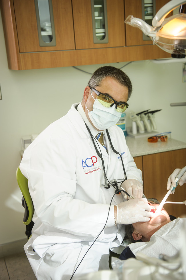 A prosthodontist is a dental specialist who focuses on the restoration and replacement of missing teeth and correcting other oral or facial issues. With their advanced training, prosthodontists are able to help patients with implants, dentures and veneers, all the way to full mouth and jaw reconstructions.