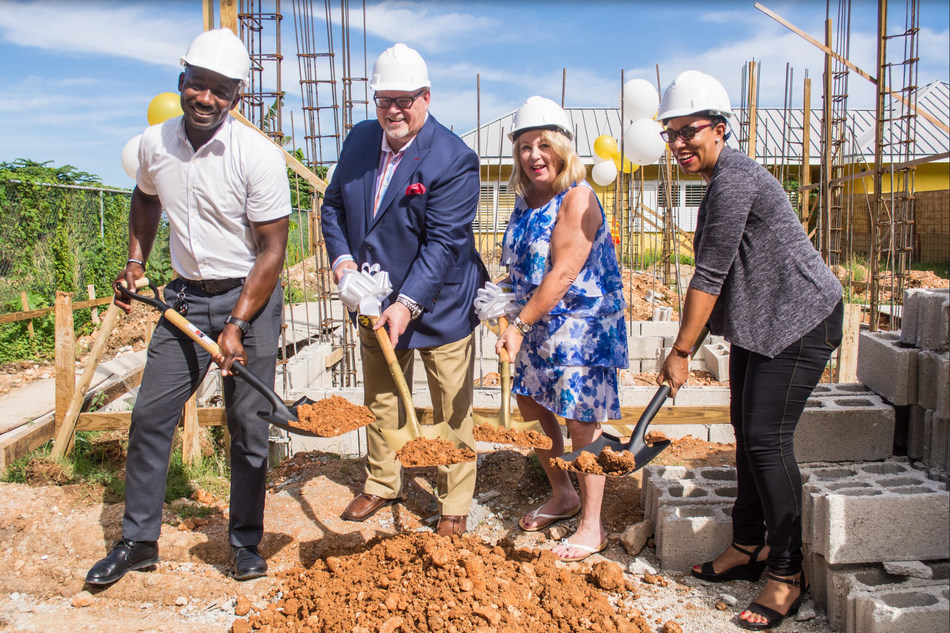 Master Spas celebrates the groundbreaking of NAZ Children's Centre's new mixed-ability high school in Montego Bay, Jamaica. Shown left to right: Oniel Campbell, Bob Lauter, Sherry Lauter, Alixann Narcisse-Campbell.