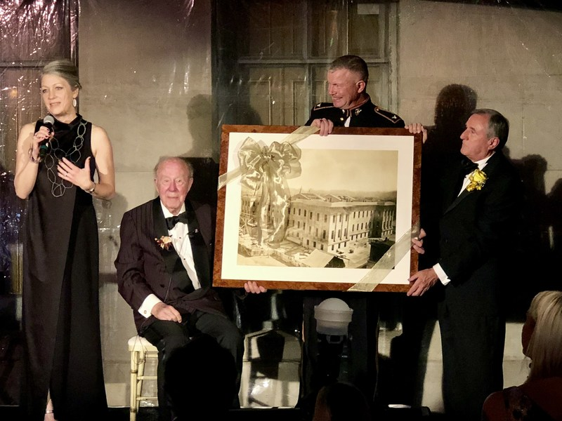 The California Historical Society celebrates The Honorable George P. Shultz during a Gala at the historic Old U.S. Mint in San Francisco. Executive Director Anthea Hartig presents a beautifully framed photograph of the U.S. Mint under construction in 1873 to Shultz for his leadership in preserving the Old Mint from sale and destruction. Pictured L to R: Hartig, Shultz, Colonel Timothy G. Burton, US Marine Corps; Michael Sangiacomo, president, Board of Trustees, California Historical Society.