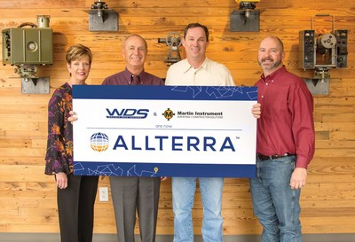 Wendy and Mike Hefer, owners of WDS, join Martin Instrument's President Bobby Hempfling and Vice President Mike Minick in announcing the merger.