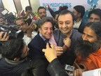 Director of Communications Bruce Schwack and CEO Pradeep Dadha enjoy the moment as Babaji announces the alliance. (PRNewsfoto/NetMeds MarketPlace Limited)