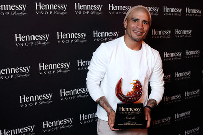 Hennessy, the world's best-selling Cognac, presents six-time championship boxer and philanthropist Miguel Cotto with the 14th annual Hennessy V.S.O.P Privilège Award following the last match of his accomplished boxing career. The private dinner celebration took place at Hunt & Fish Club in New York City. Manny Gonzalez, Senior Director, Multicultural Marketing, Moët Hennessy presented Cotto with the award along with a donation to support the boxer's ongoing community efforts.