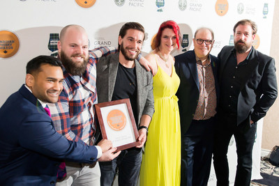 Corby Distillery team accept Whisky of the Year for JP Wiser's 35 year old. L to r: Brand director Chris Bhowmik, Colin MacDougal, Spencer Gooderham, Co-host Heather Leary, Chair & Co-host Davin de Kergommeaux and Dave Mitton. (CNW Group/Canadian Whisky Awards)