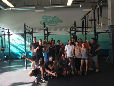 Dumbbell and kettlebell lifting clinic participants are looking and feeling strong.