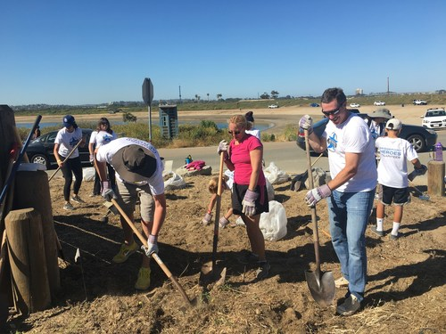 Volunteers at one of Bridgepoint Education's annual volunteer events, including CEO Andrew Clark (right), help enhance the Fiesta Island Youth Camp in San Diego.