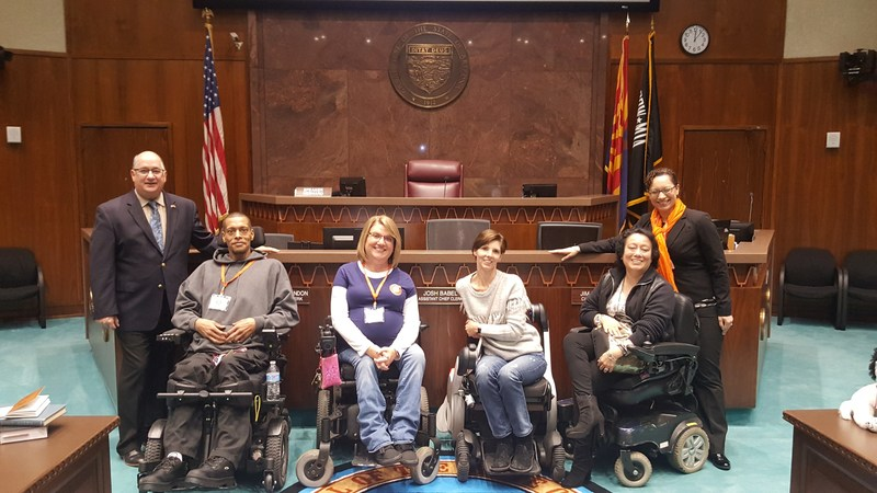 United Spinal Accessible Arizona members with Majority Leader John Allen (on left) at the Arizona House of Representatives and United Spinal VP, Government Relations, Alexandra Bennewith (on right)