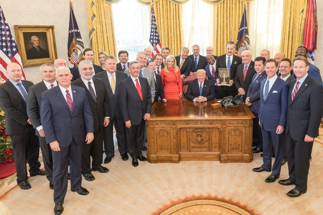 Dr. Mike Evan presenting the Friends of Zion award to President Trump with Vice President Pence, Senior Advisors Jared Kushner and Ivanka Trump, Special Representative for International Negotiations Jason Greenblatt, and faith leaders representing over 150 million Christians globally