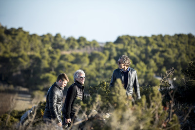Jesse Bongiovi (left), Jon Bon Jovi (center), and Gérard Bertrand (right) climbing the hill at wine estate, Château l'Hospitalet, in southern France. Photo credit: David Fritz Goeppinger