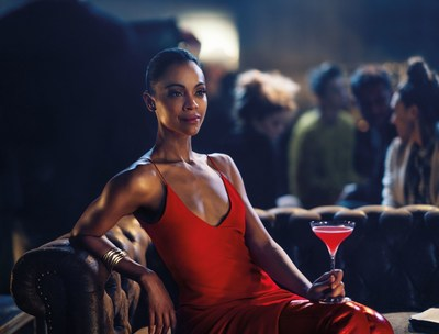 Zoe Saldana plays Mia Parc in the Campari Red Diaries Legend of Red Hand short movie, pictured wearing Fendi Red Boots and Vhernier Plisse bracelet in satin rose gold, with a Shaken Campari cocktail. Image by Matteo Bottin (PRNewsfoto/Campari)