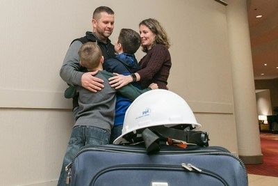 PPL Journeyman Lineman Jason Roberts of Lackawanna County shares a moment with his family before leaving for a month of power restoration work in Puerto Rico.