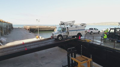 A PPL bucket truck is unloaded at the port of Ponce, Puerto Rico.