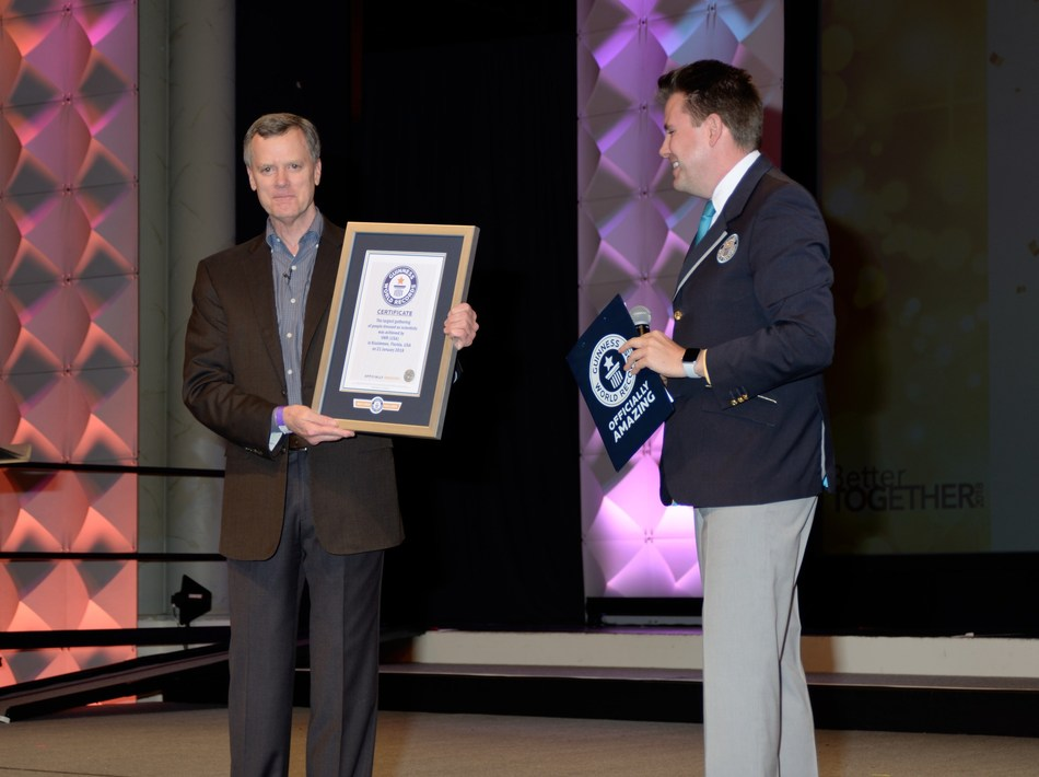 VWR, part of Avantor, employees set Largest gathering of people dressed as scientists title at Americas Sales Conference in Orlando, Florida. Pictured: Mark McLoughlin, EVP, Americas (left) and Michael Empric, Guinness World Records (right).