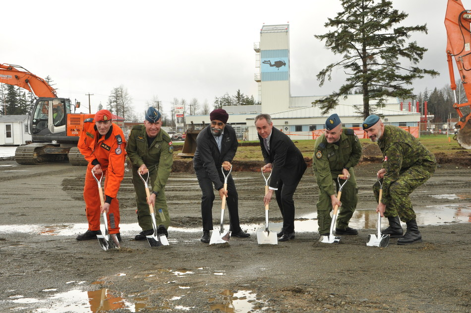 The attached photo shows WO Francois Duchesneau, Search and Rescue Technician; BGen Sean Boyle, Deputy Commander 1 Canadian Air Division; The Hon. Harjit Sajjan, Minister of National Defence; Mr. Boris Burlot, CEO AirPro; LCol Curtis Wright, A/Wing Commander; and CWO Keith Sexstone, A/ Wing CWO at the official groundbreaking at CFB Comox. (CNW Group/Airbus Defence and Space)