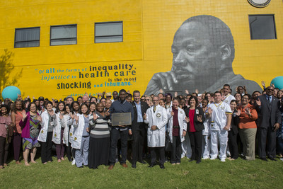 Covered California Executive Director Peter V. Lee is in the center of the picture.  To the left of Mr. Lee, holding a plaque, is mural artist, Shawn Michael Warren. To the right of Mr. Lee is Dr. David M. Carlisle, President and CEO of Charles R. Drew University of Medicine and Science.