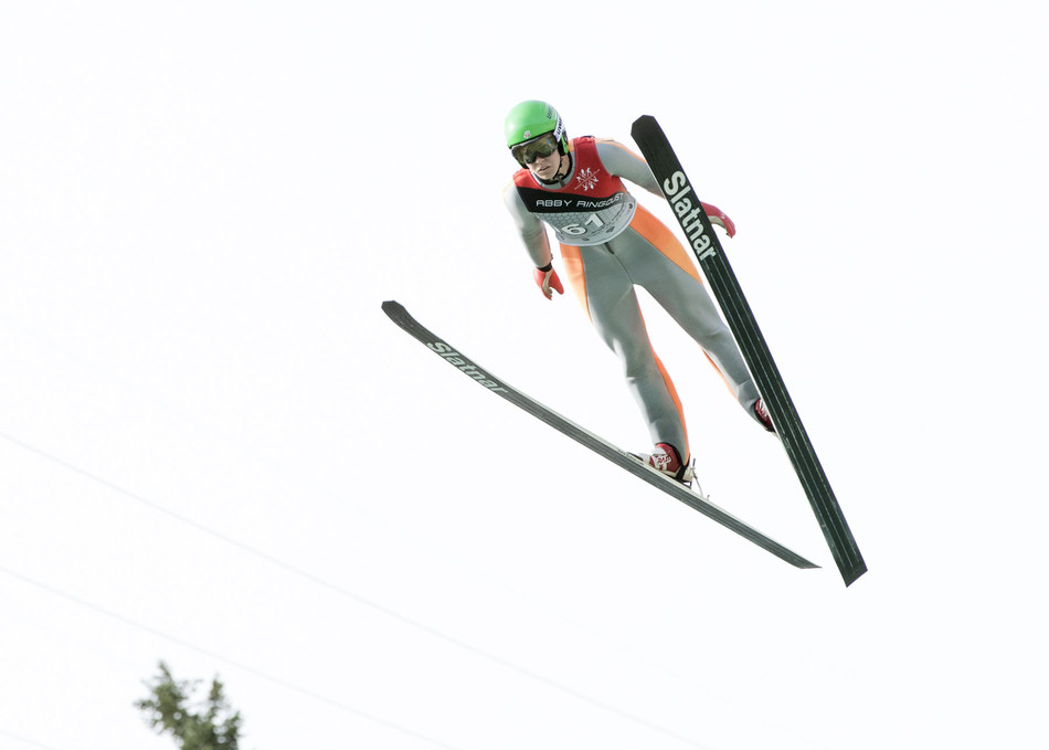 Abby Ringquist, a member of the U.S. Women's Ski Jumping team, joins Team USA in the Winter Games thanks to support from The 1,000 Dreams Fund.  Photo Credit: Ben Pieper Photography