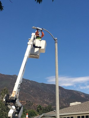 Installer in process of upgrading streetlights to LEDs with smart controllers.  Photo courtesy of City of Ranch Cucamonga.