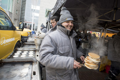 Angelo Speciale, one of Enbridge's Community Events coordinators holds a stack of pancakes at last year's Annual Enbridge Pancake Breakfast. (CNW Group/Enbridge Gas Distribution)