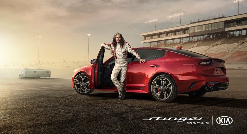Steven tyler and emerson fittipaldi hit the racetrack in for Kia motors of america