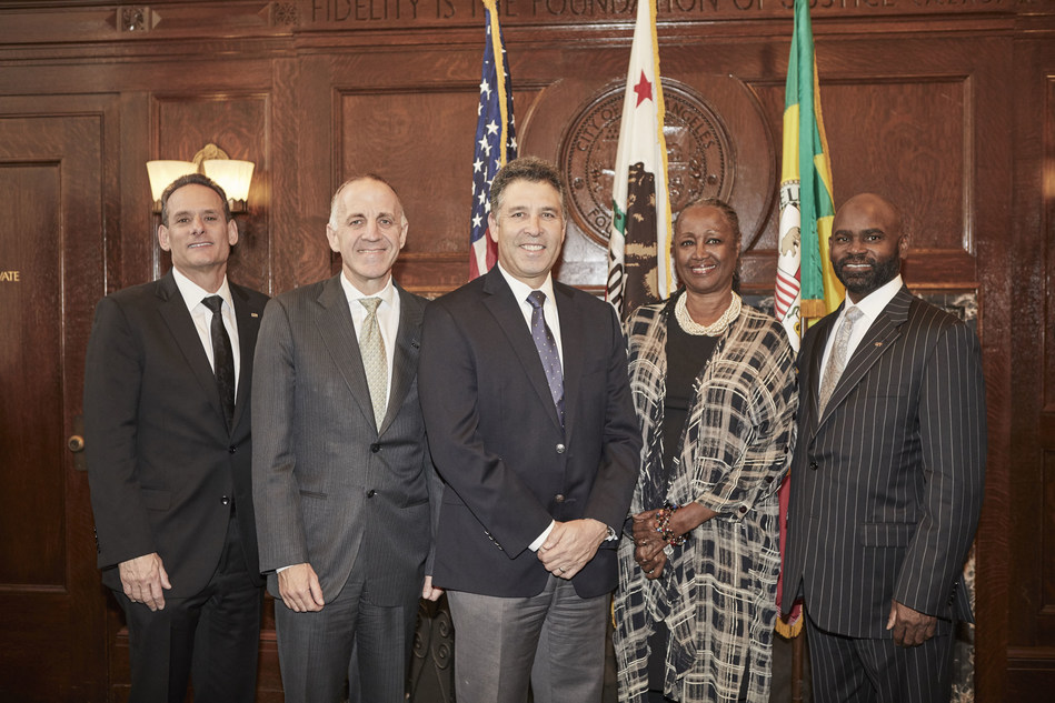 CIT's Steve Solk, Aaron Wade and Byron Reed pictured with HCIDLA general manager Rushmore Cervantes and L.A.'s deputy mayor for economic opportunity Brenda Shockley.