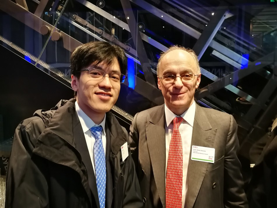 Leo Zhu (L), CEO and co-founder of YITU Technology and Lord James Sassoon, chairman of China-Britain Business Council at China-UK Business Forum in Shanghai on Feb 2.