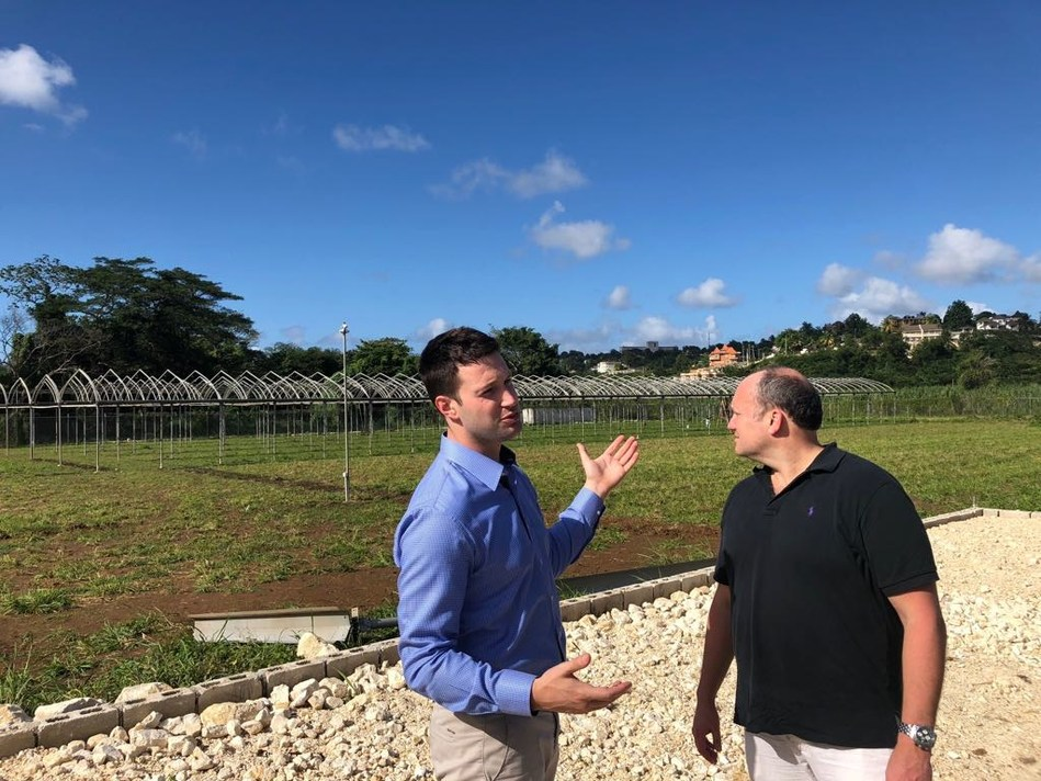 John McMullen, LGC Capital's CEO, with Paul Glavine, Global Canna Labs CEO, inspecting the installation of the Canadian sourced greenhouse frames at Montego Bay in Jamaica. (CNW Group/LGC Capital Ltd)
