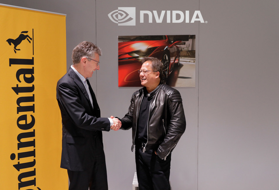 Continental CEO Dr. Elmar Degenhart shakes hands with founder and NVIDIA CEO Jensen Huang.