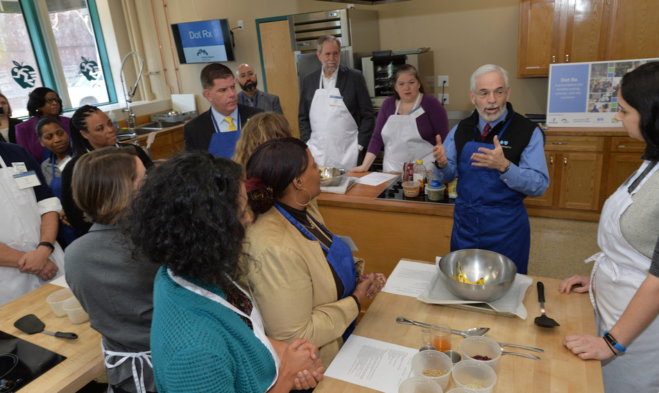 Representatives from Blue Cross Blue Shield of Massachusetts, Codman Square Health Center, Daily Table, the Dorchester YMCA, Healthworks Community Fitness, Outdoors Rx, a program of the Appalachian Mountain Club, and Union Capital Boston participated in a healthy cooking class to celebrate the launch of Dot Rx. The program connects Dorchester families with peer health coaches and local experiences that promote healthy living - including opportunities to eat healthy, get outside, and be active.