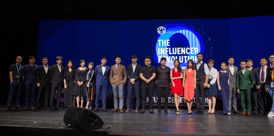 Group photo of VIPs and founders of Influence Chain at the grand opening.